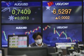 Μικτές τάσεις στα ασιατικά χρηματιστήρια λόγω «εκτίναξης» των κρουσμάτων